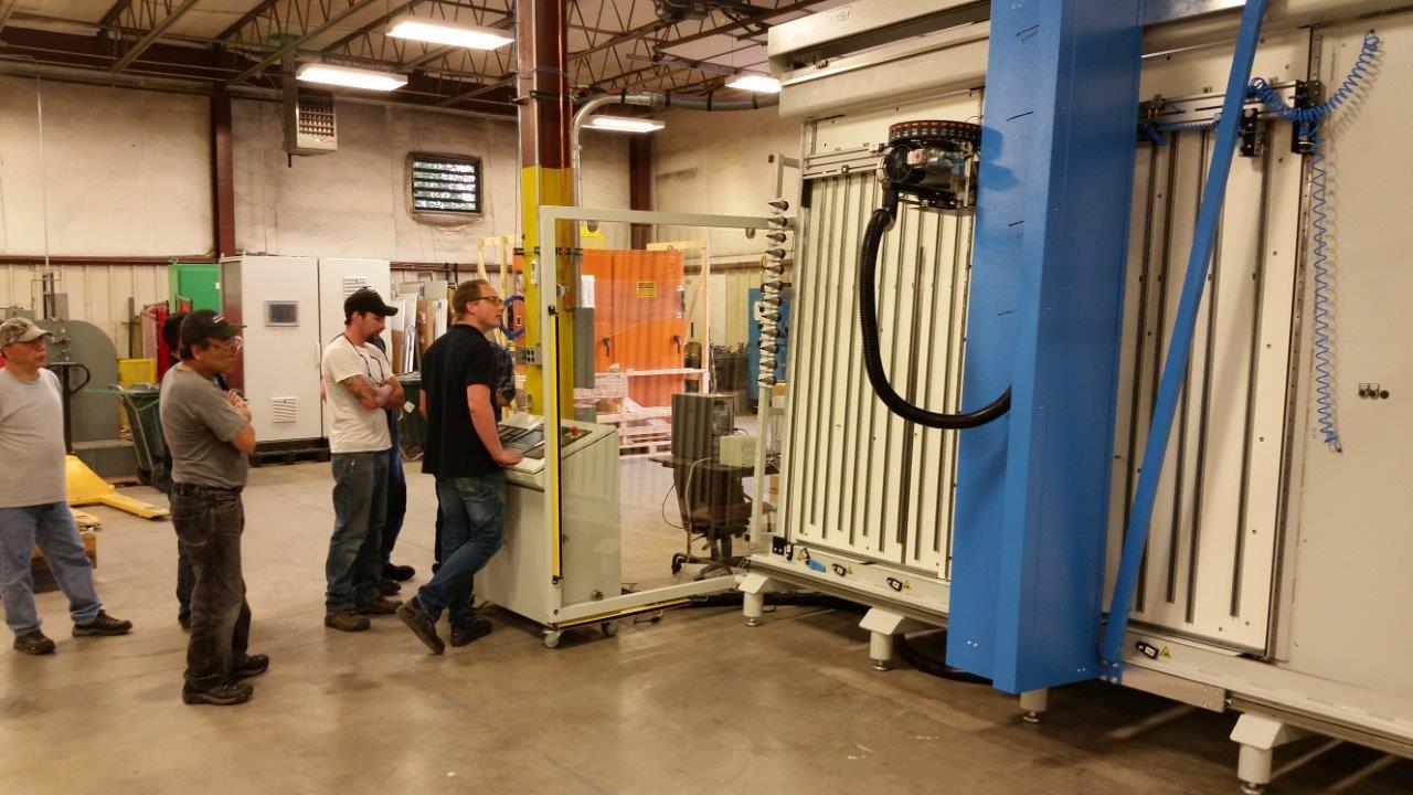 The UCEC team trains on the new  MC-80 machine .