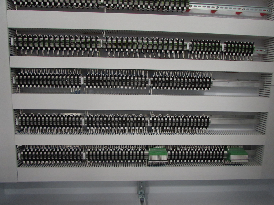 """This picture shows how we stagger the horizontal Panduit sizes, small, big, small, big, etc. Notice that99 percentof the wiring is inside the small wire duct.That is what we call a """"panel"""" Panduit and the empty one we call """"field"""" Panduit."""