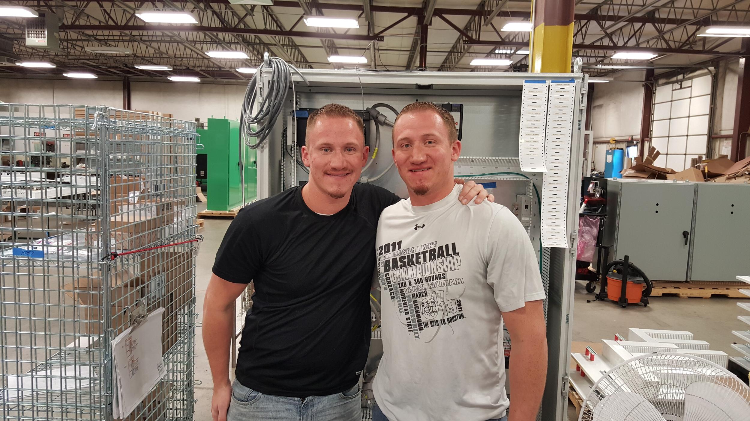 Wire Technicians Maverick (left) and Winston Bollig