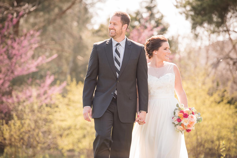 bride and groom walking in spring