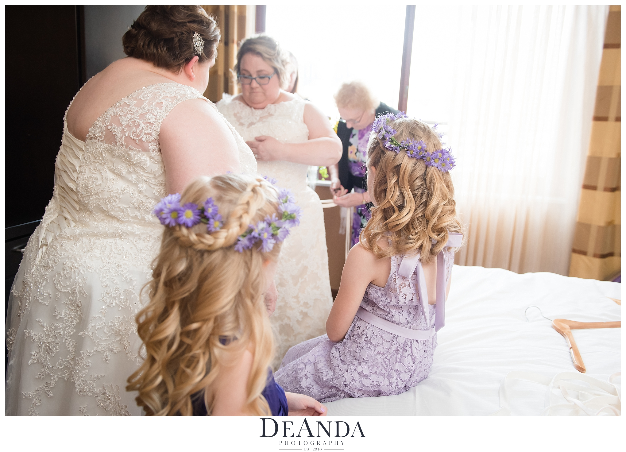 two brides getting ready for their wedding