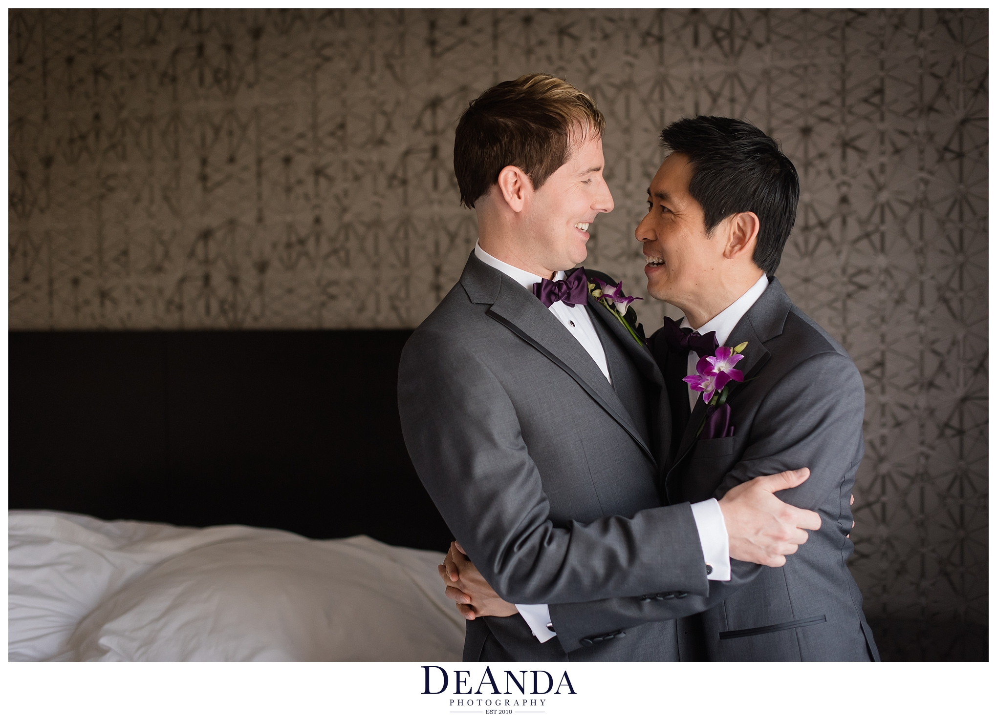 grooms looking at each other happily