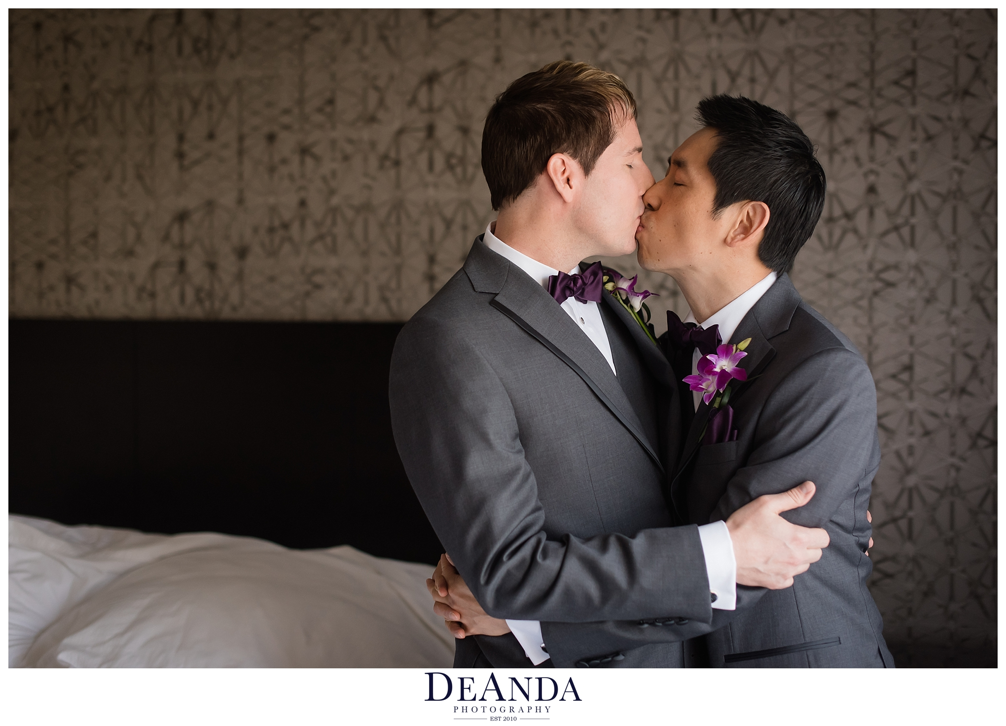 two grooms kissing each other