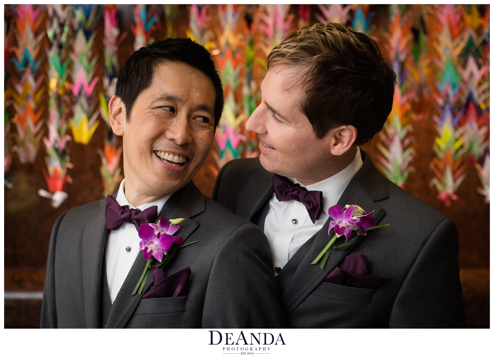 two groom in front of paper cranes
