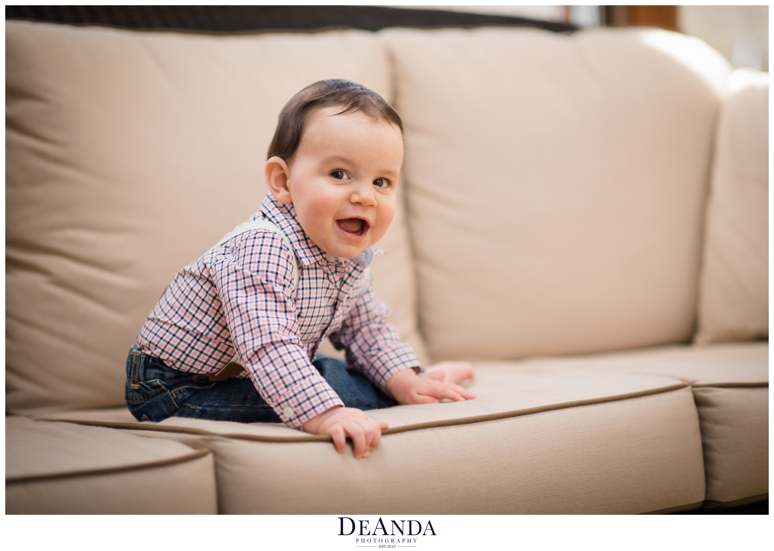 smiling 7 month old baby on couch