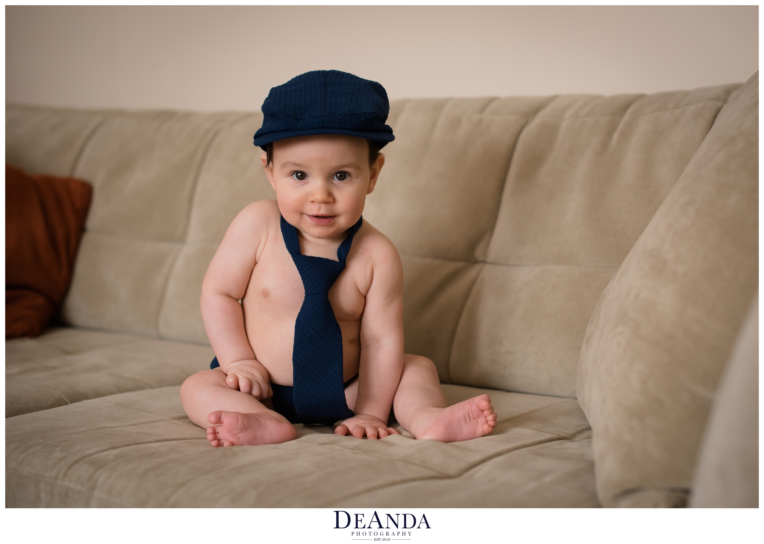 7 month old in hat and tie