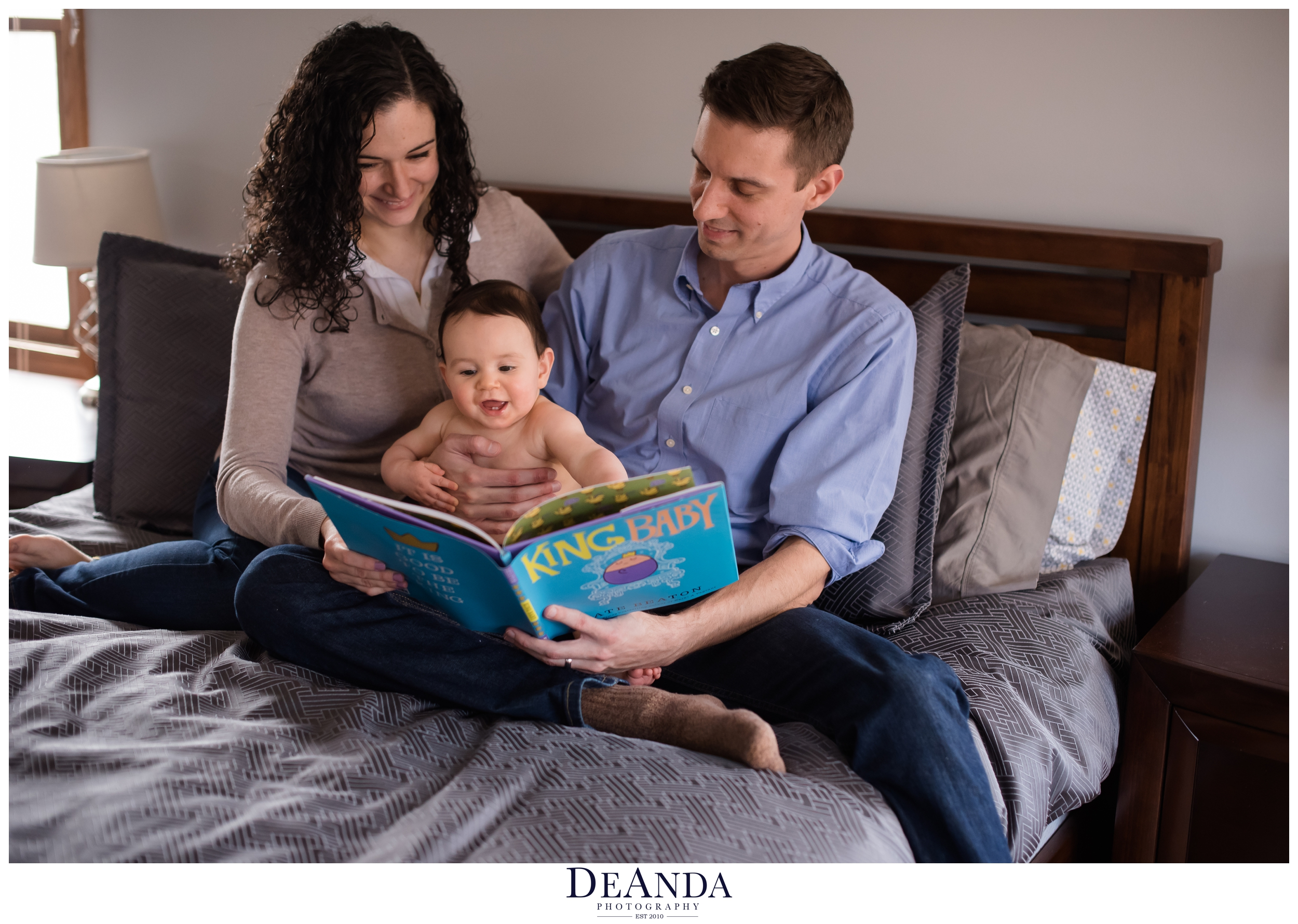 mom and dad reading king baby