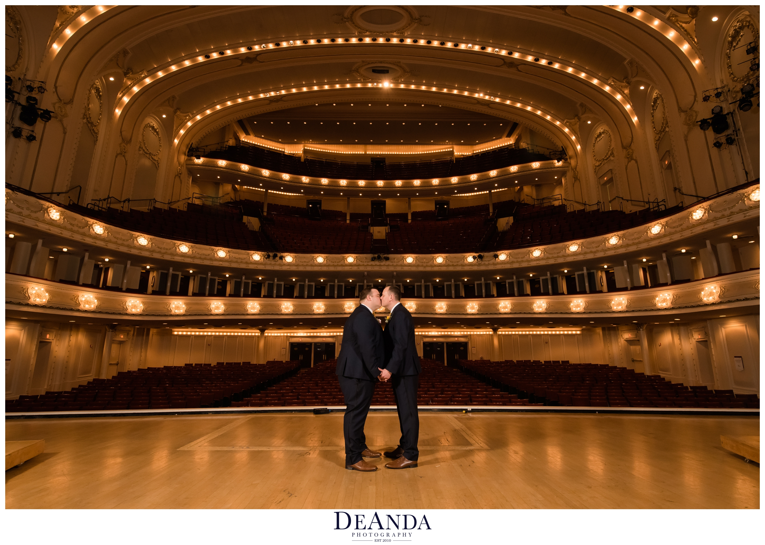 grooms kissing on symphony center stage
