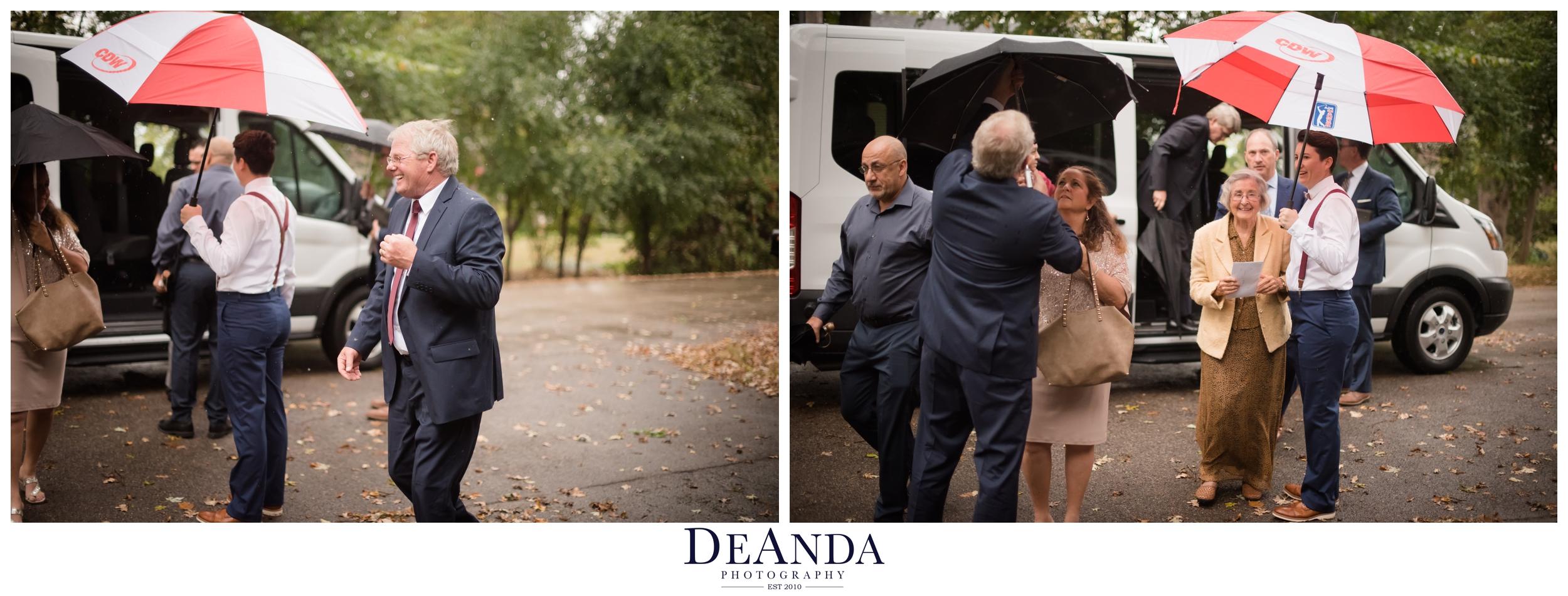 guests arriving under umbrellas to rainy October wedding in Chicago