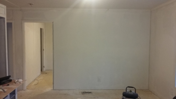 Elizabeth Burns Design   How to Flip Houses - living room after with carpet removed and drywall installed