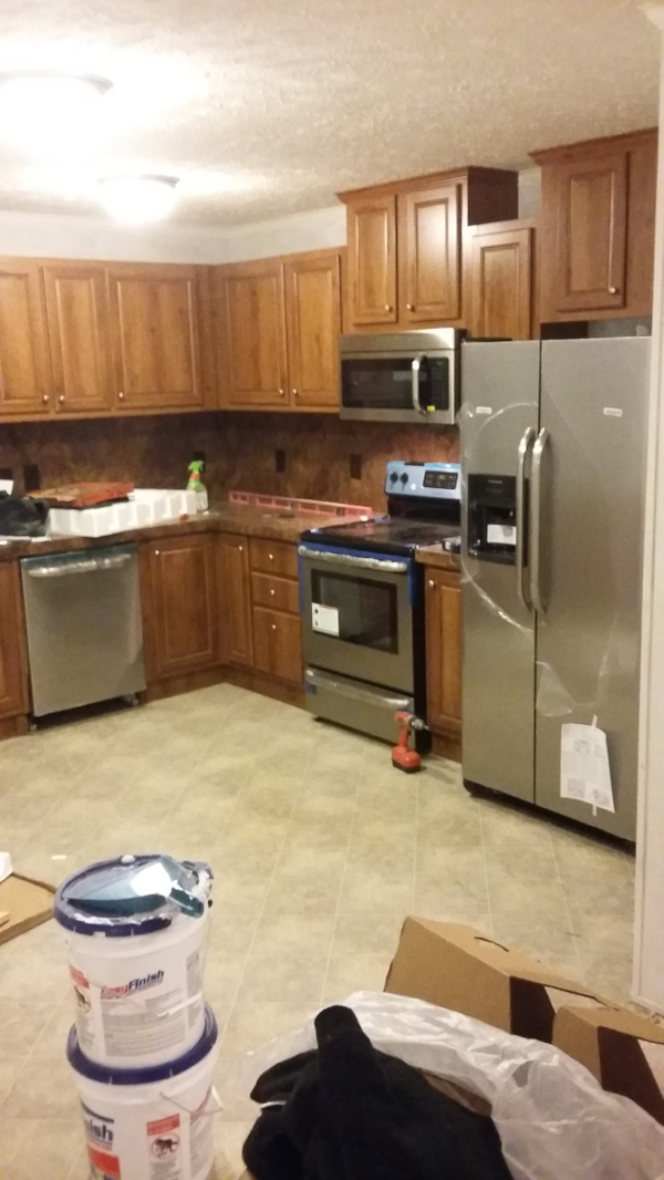 Elizabeth Burns Design   How to Flip Houses - kitchen during with new stainless steel appliances