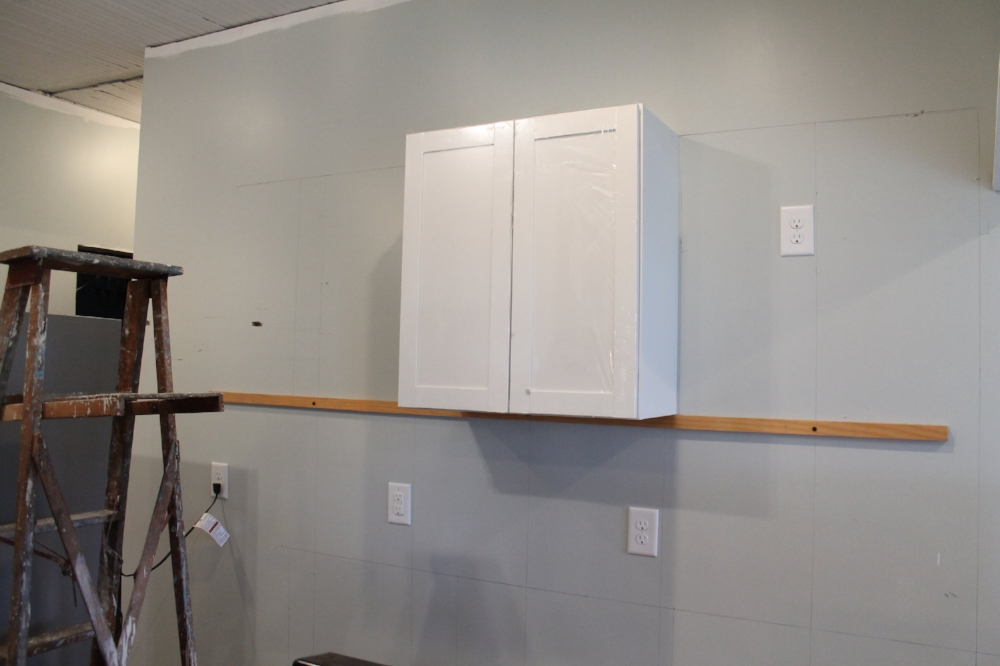 How to Install Kitchen Cabinets - install the upper cabinets first | Elizabeth Burns Design