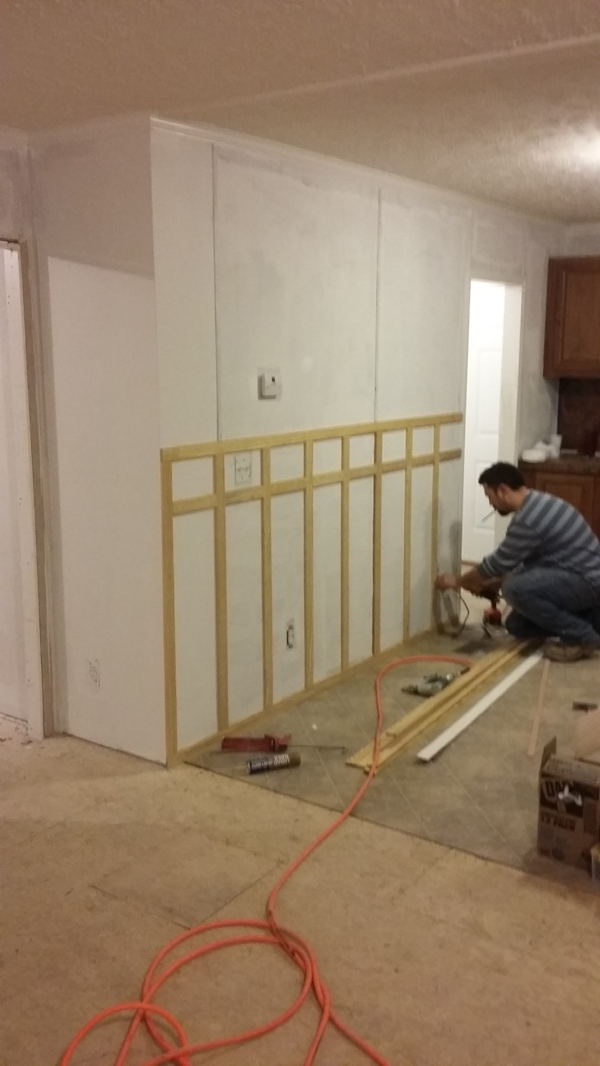 How to Flip a House on the Cheap - our first investment property - DIY board and batten wainscoting | Elizabeth Burns Design