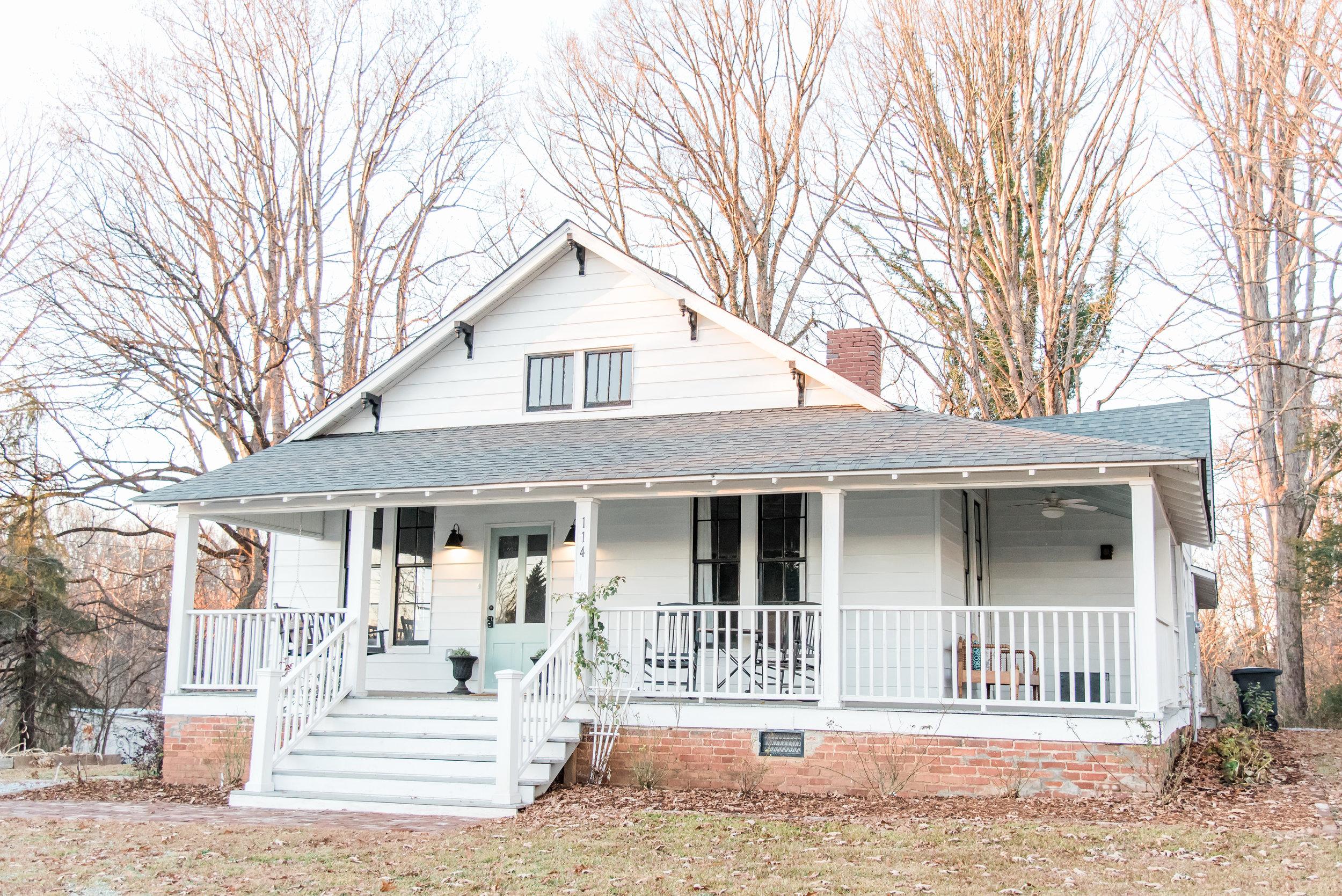 Elizabeth Burns Design | Farmhouse Renovation - white siding black windows, wraparound front porch