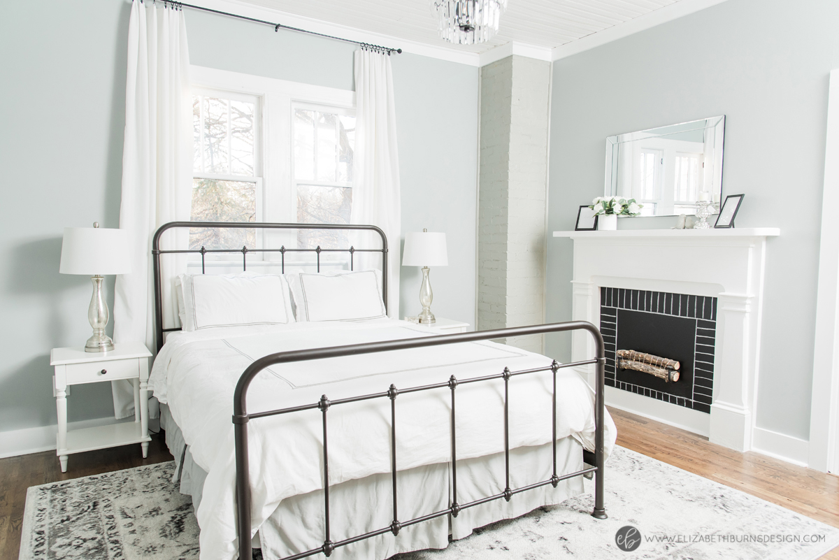 Elizabeth Burns Design | Whole House Paint Color Scheme - Sherwin Williams Magnetic Gray in Bedroom with White and Gray Accents and Faux Fireplace Mantle