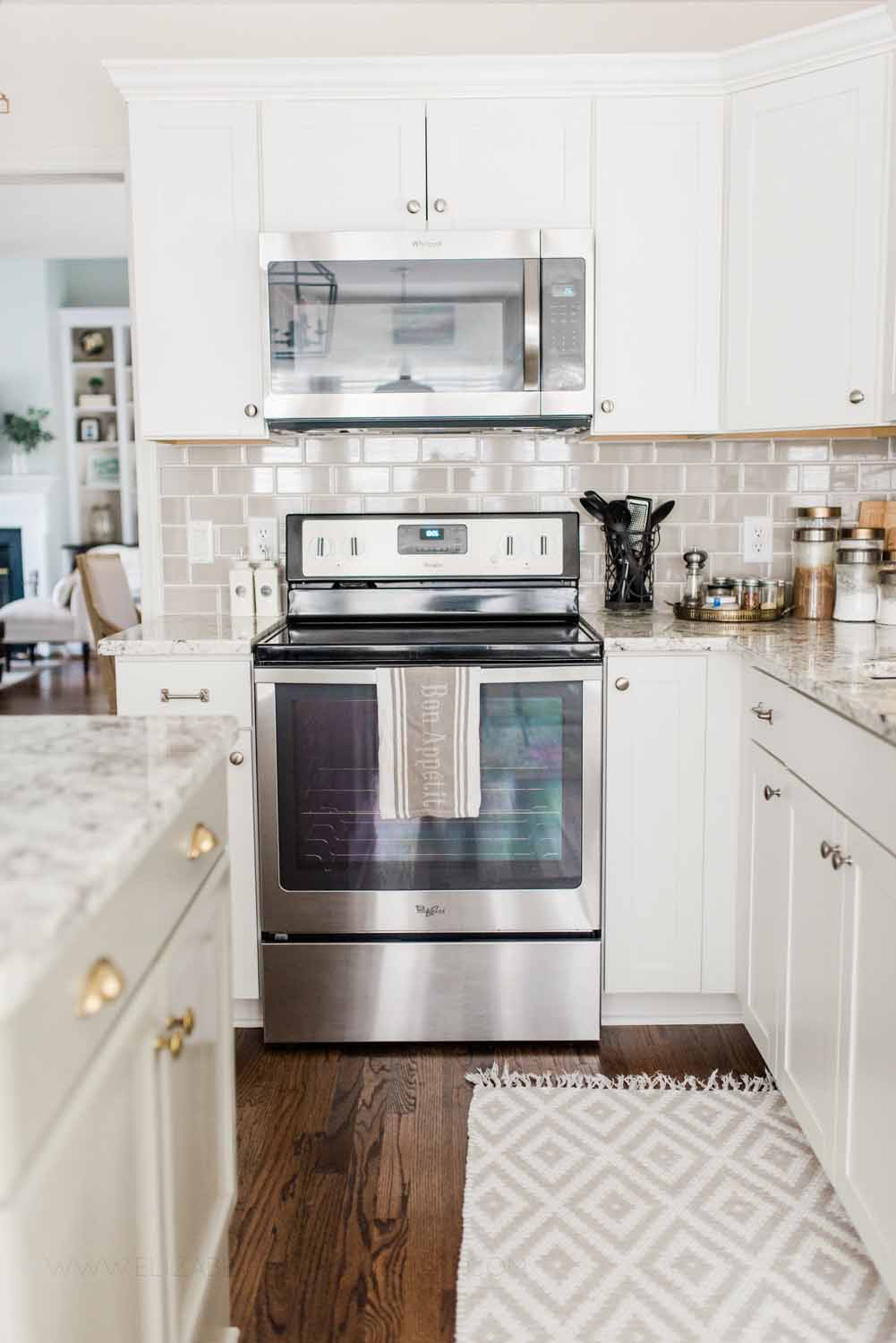 Elizabeth Burns Design Raleigh Interior Designer 1990s house remodel before and after Benjamin Moore Classic Gray 1548 Arcadia White Shaker Cabinets Gray Subway Tile Backsplash (8).jpg