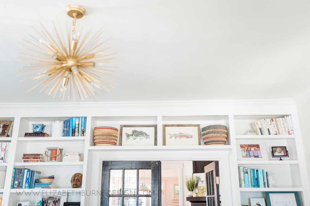 Elizabeth Burns Raleigh Interior Designer Modern Living Room Sputnik Chandelier Built-in Shelves Old House Pine Floors (34).jpg