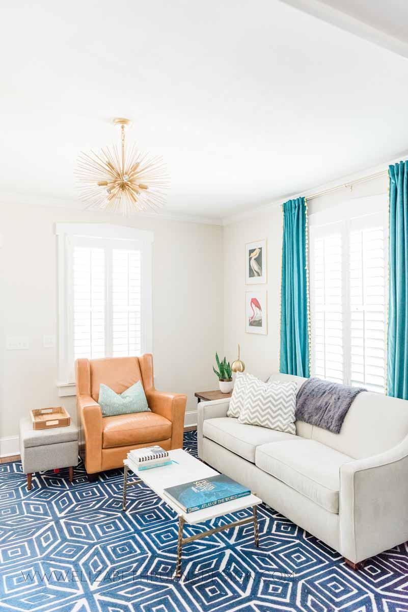 Elizabeth Burns Raleigh Interior Designer Modern Living Room Sputnik Chandelier Built-in Shelves Old House Pine Floors (35).jpg