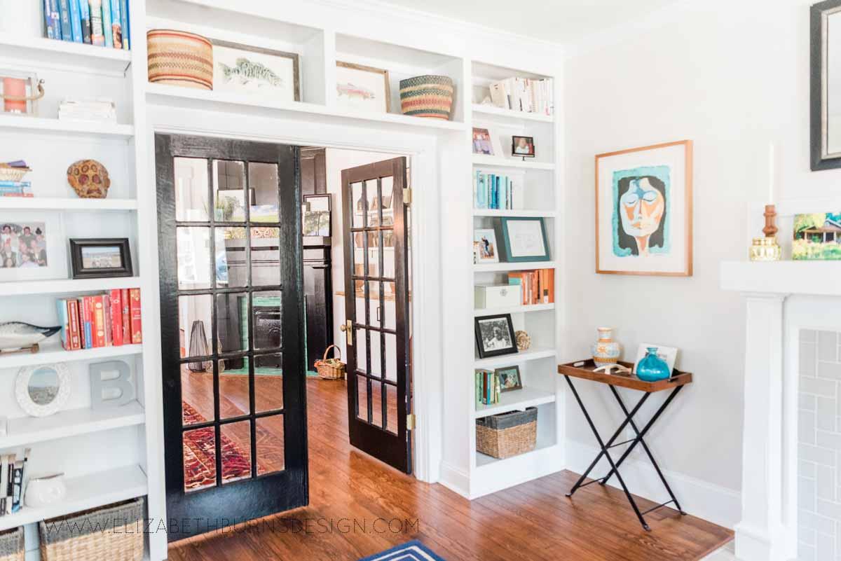 Elizabeth Burns Raleigh Interior Designer Modern Living Room Sputnik Chandelier Built-in Shelves Old House Pine Floors (43).jpg
