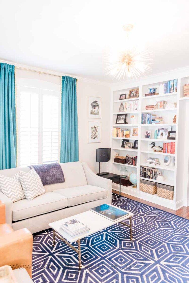 Elizabeth Burns Raleigh Interior Designer Modern Living Room Sputnik Chandelier Built-in Shelves Old House Pine Floors (1).jpg