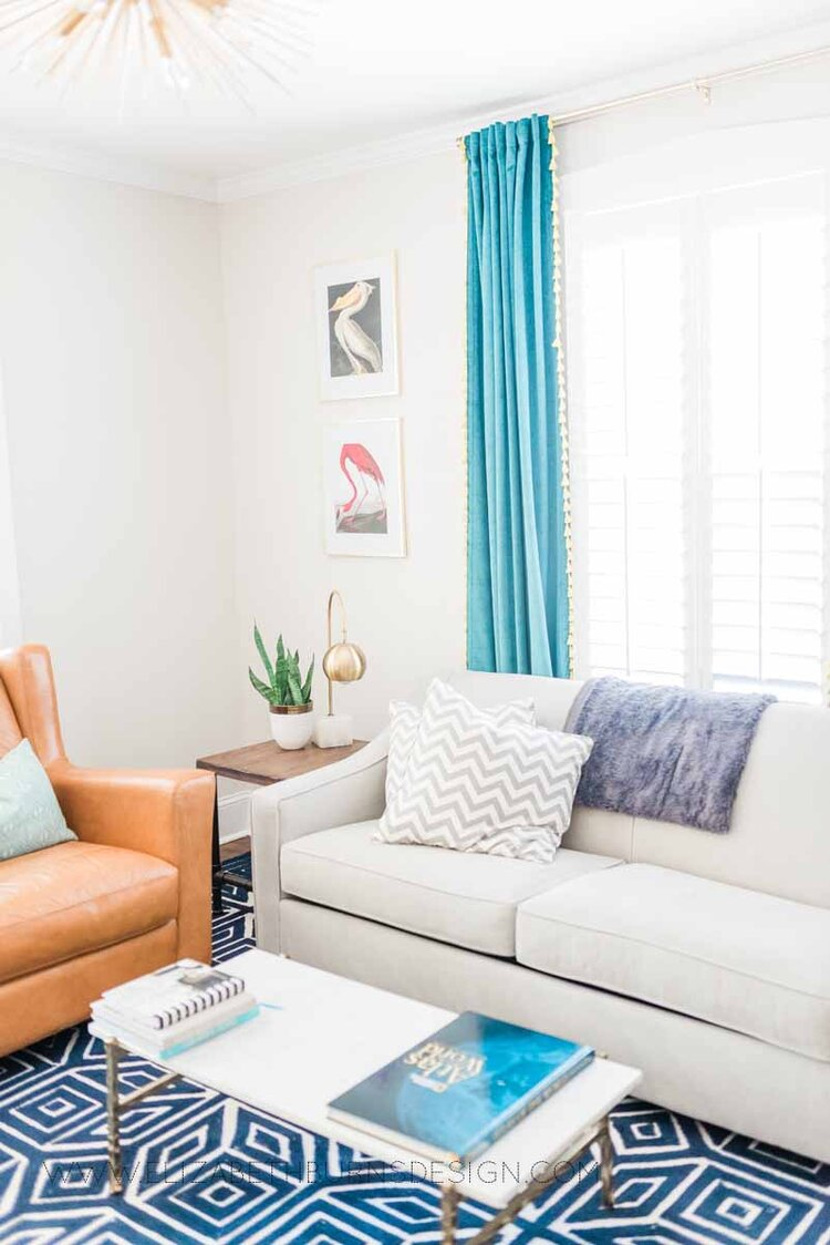 Elizabeth Burns Raleigh Interior Designer Modern Living Room Sputnik Chandelier Built-in Shelves Old House Pine Floors (3).jpg