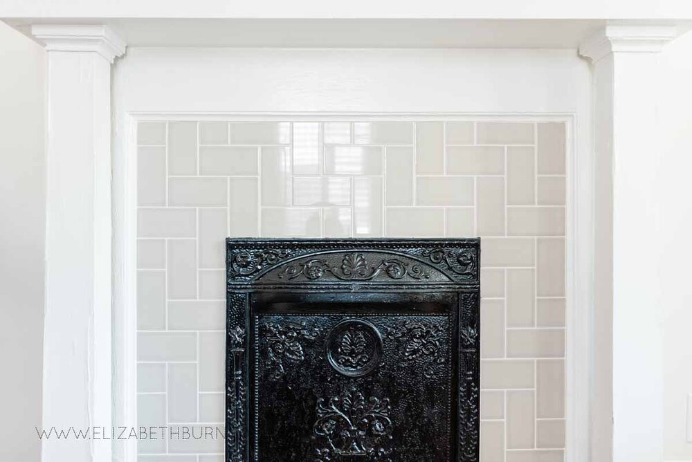 Elizabeth Burns Raleigh Interior Designer Modern Living Room Sputnik Chandelier Built-in Shelves Old House Pine Floors (23).jpg