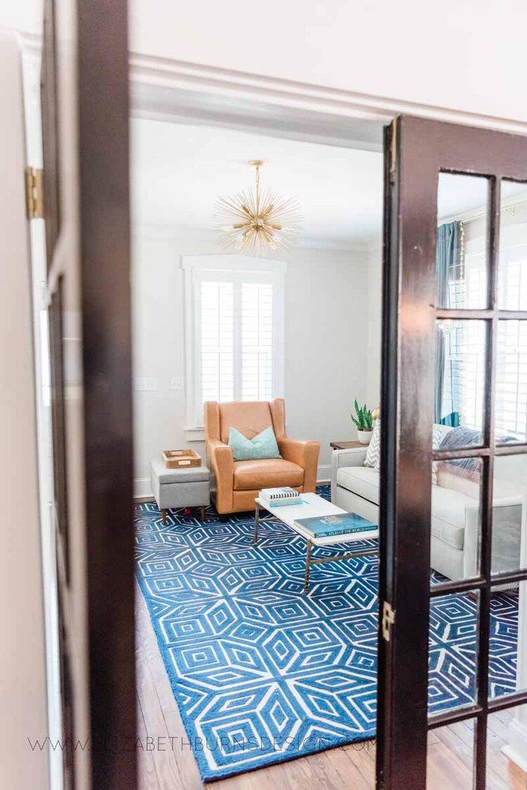 Elizabeth Burns Raleigh Interior Designer Modern Living Room Sputnik Chandelier Built-in Shelves Old House Pine Floors (36).jpg