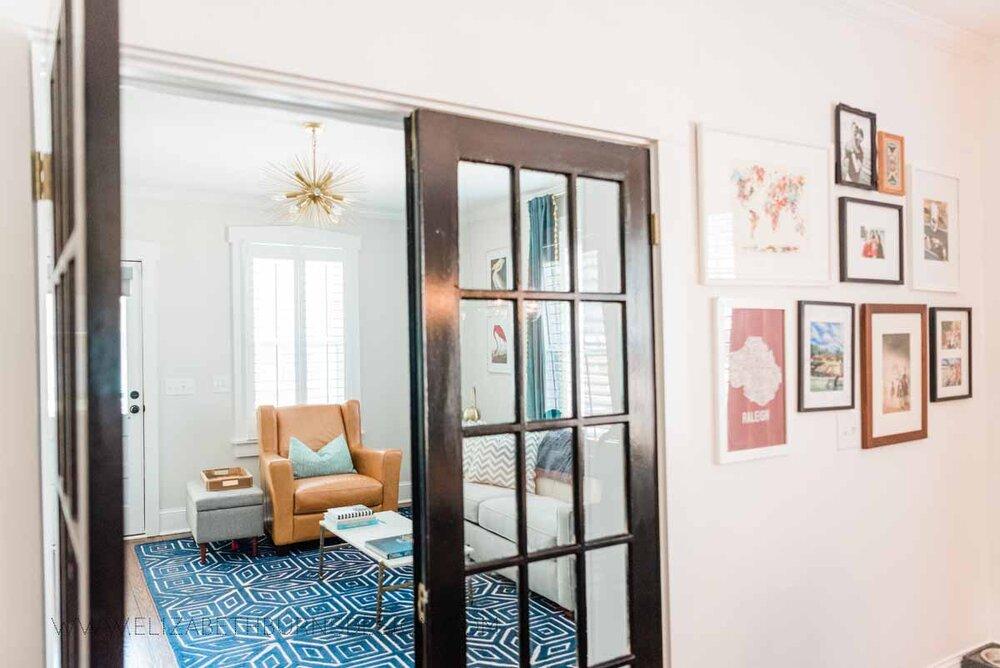 Elizabeth Burns Raleigh Interior Designer Modern Living Room Sputnik Chandelier Built-in Shelves Old House Pine Floors (37).jpg