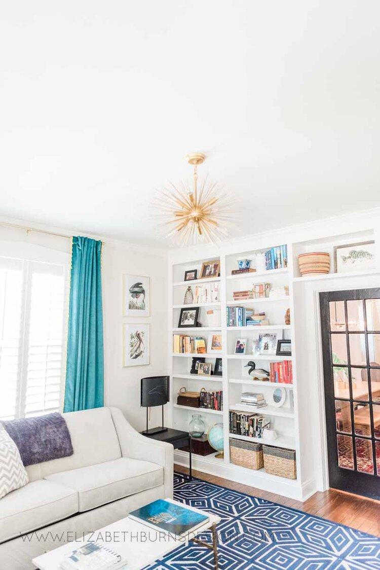 Elizabeth Burns Raleigh Interior Designer Modern Living Room Sputnik Chandelier Built-in Shelves Old House Pine Floors (40).jpg