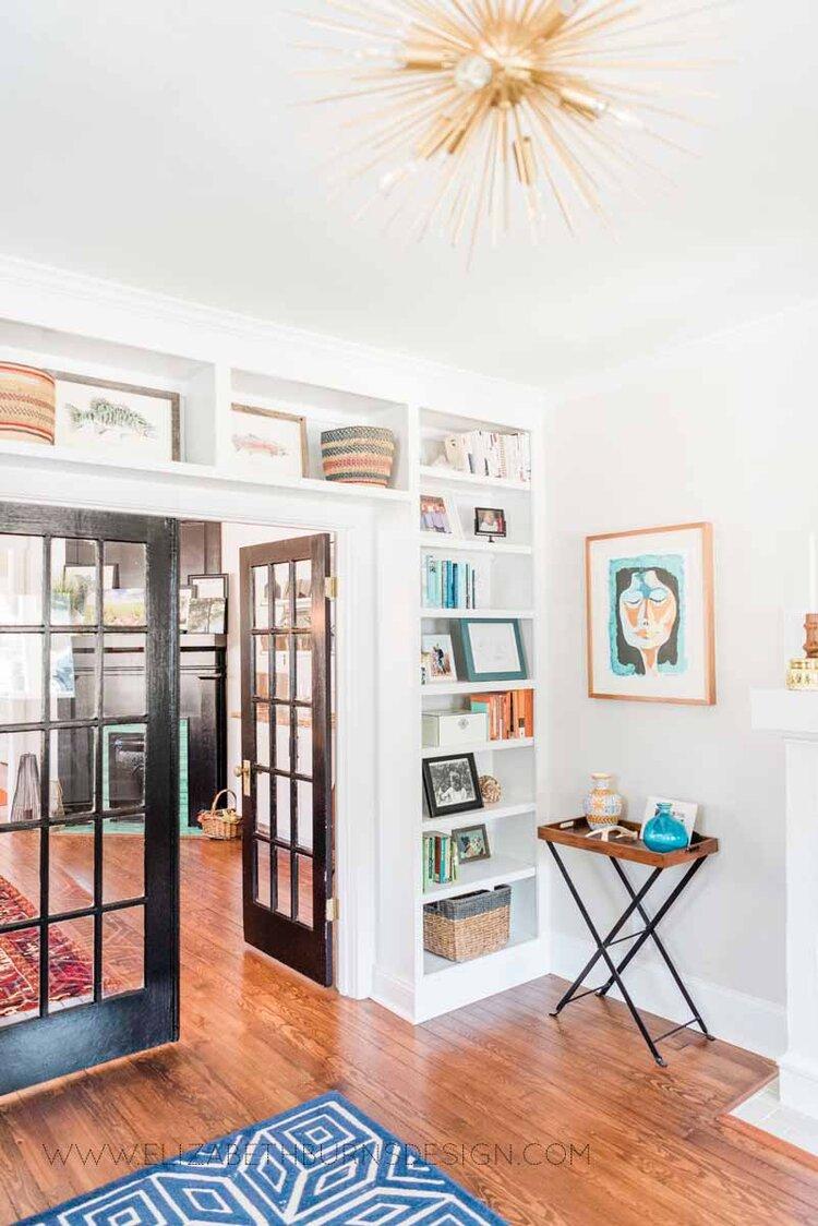 Elizabeth Burns Raleigh Interior Designer Modern Living Room Sputnik Chandelier Built-in Shelves Old House Pine Floors (42).jpg
