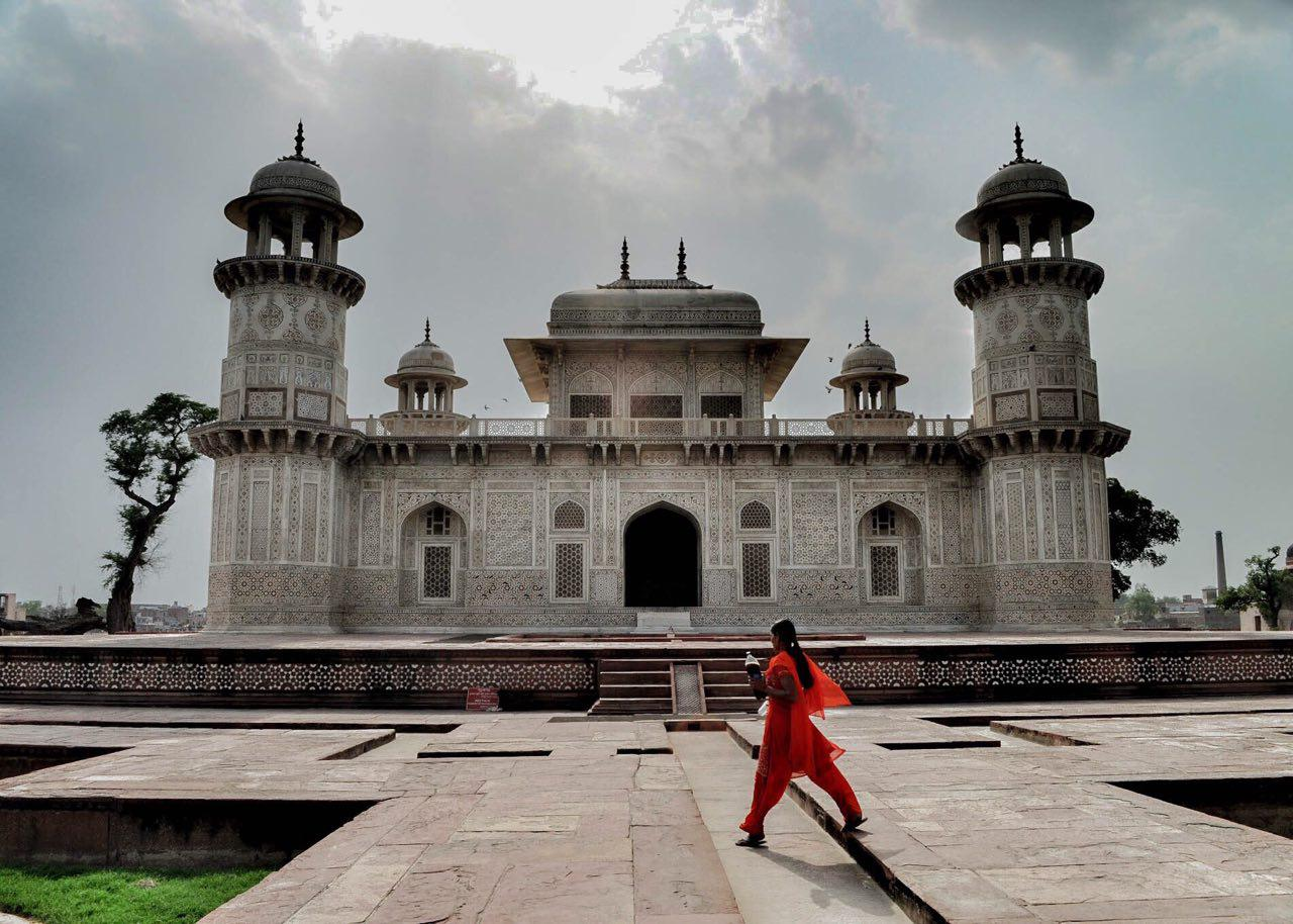 Girl in Red passing through the Tomb of I'timād-ud-Daulah