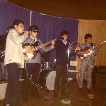 My dad being all Mod with his bandmates. He's wearing the navy Harrington, tartan pants and Chelsea boots.