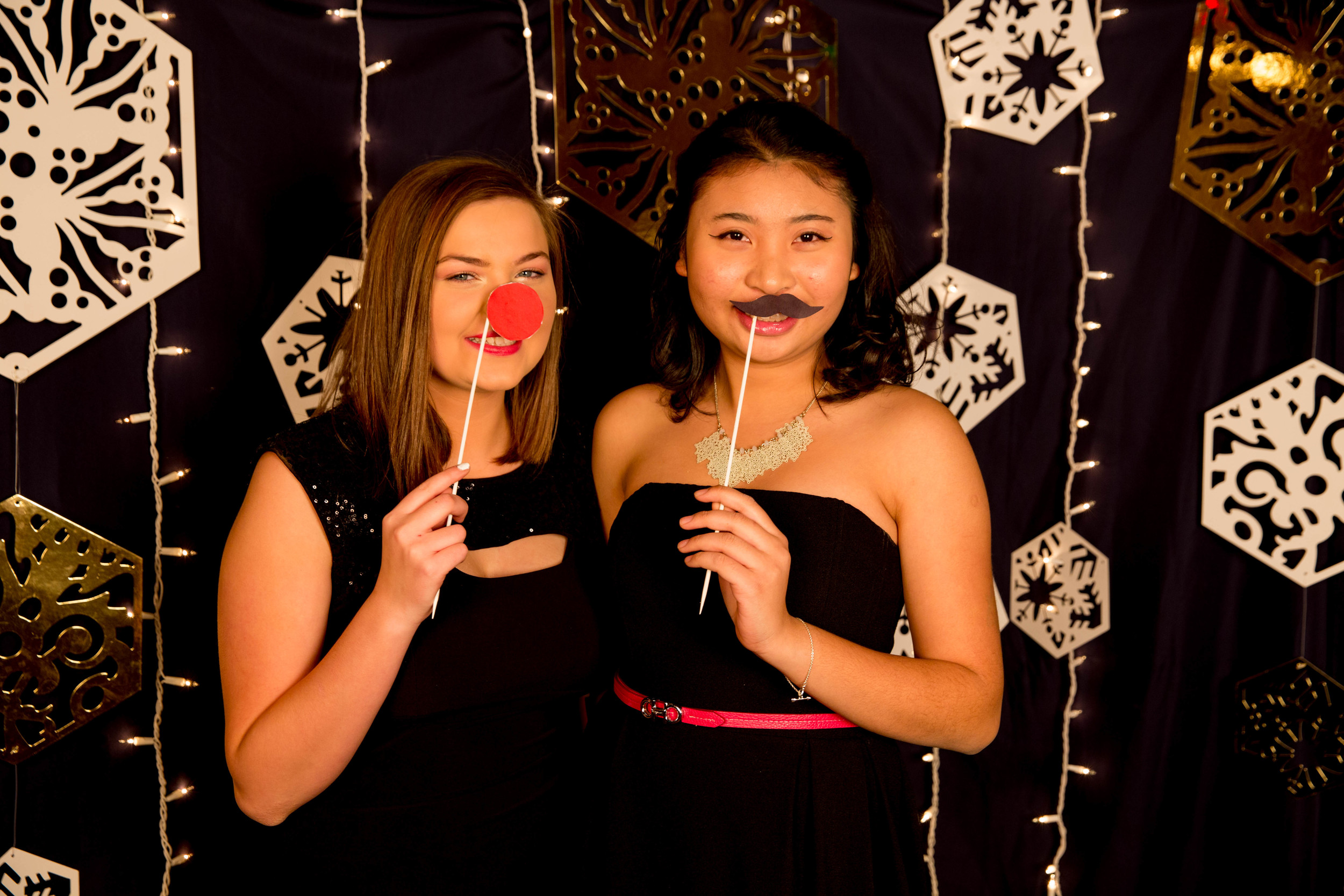 Nhi Nguyen and Ashley Jarvi pose at Hillcrest's Christmas banquet photobooth