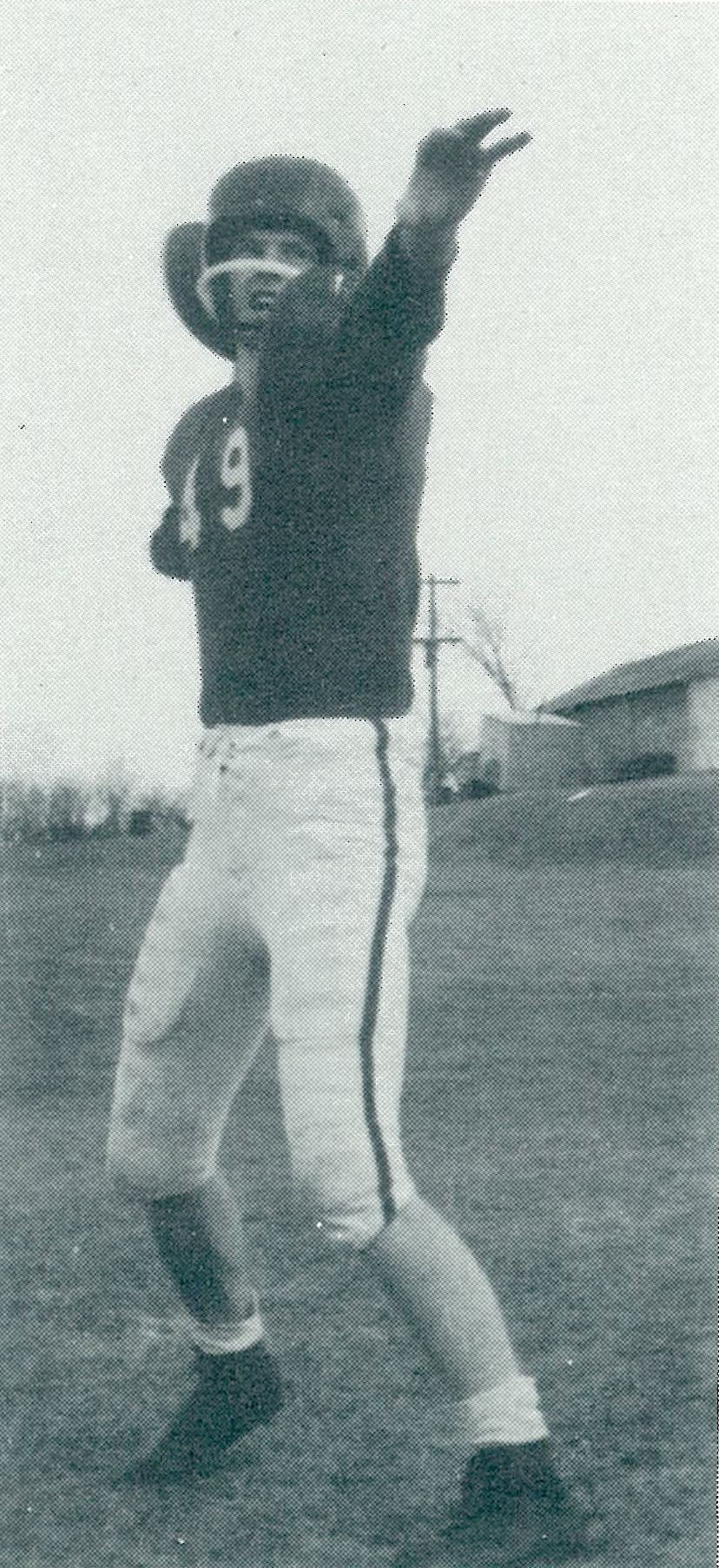G.T. Gunhus poses in his football gear for a yearbook photo in 1957.