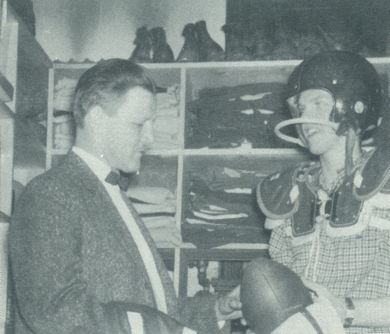Coach Werdal passes out equipment to G.T. Gunhus to start the 1958 season.