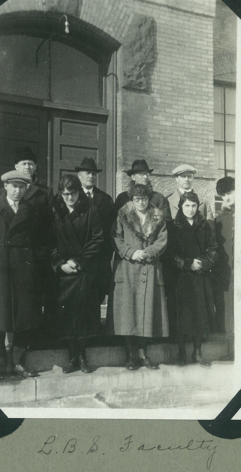 E.M. Broen, pictured with a handful of the Hillcrest and Bible School faculty, watched his staff carry his vision for Hillcrest Academy by going with no or reduced-pay for five years during some of Hillcrest's darkest times financially.