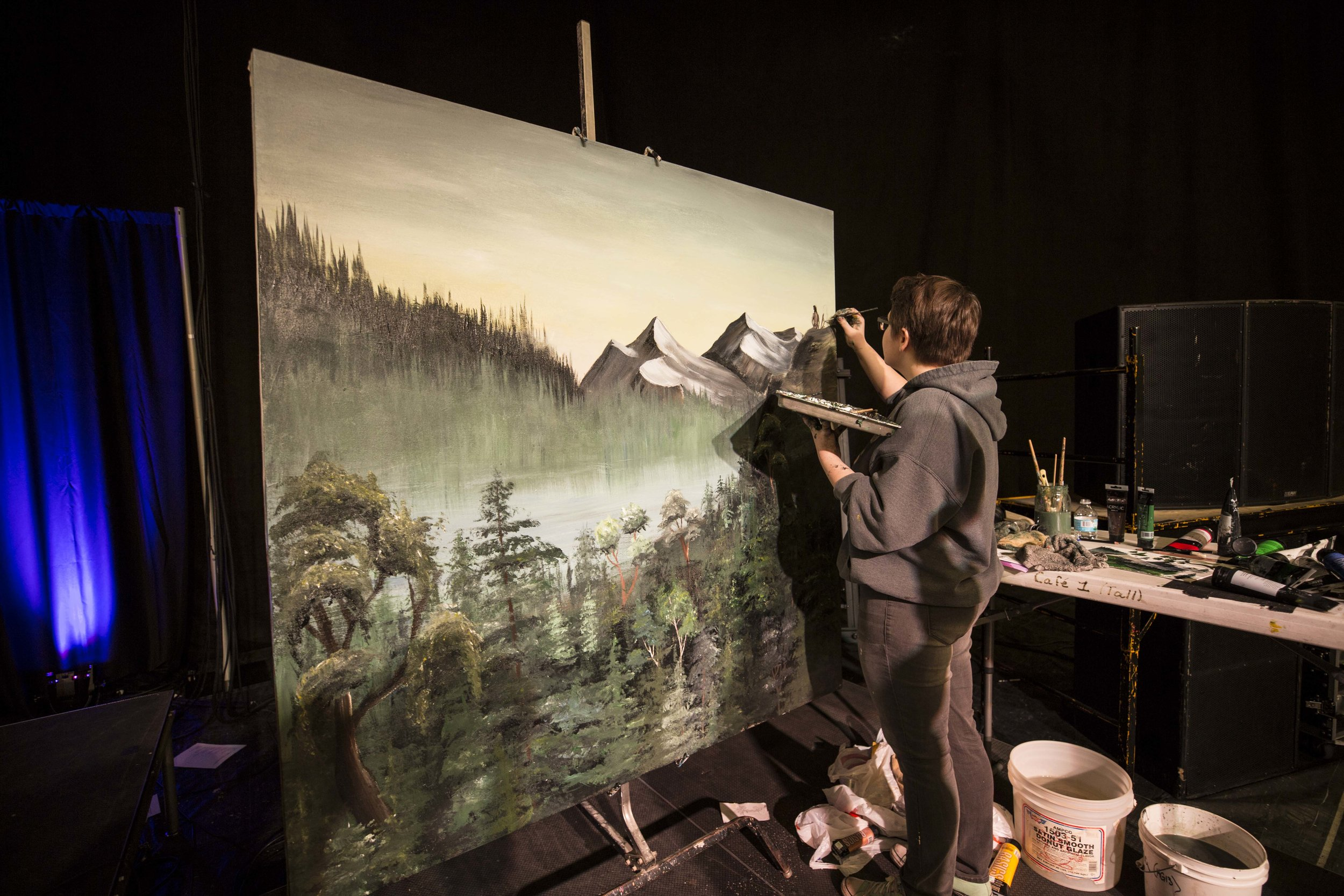 Sylvia Venberg paints creation on day one of Prayer Day