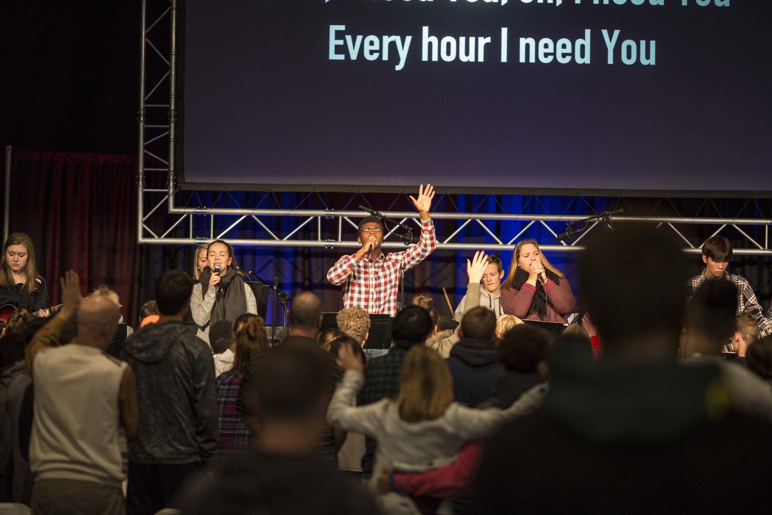 Sam Ihrke leads the Praise Team during the Prayer Day worship set