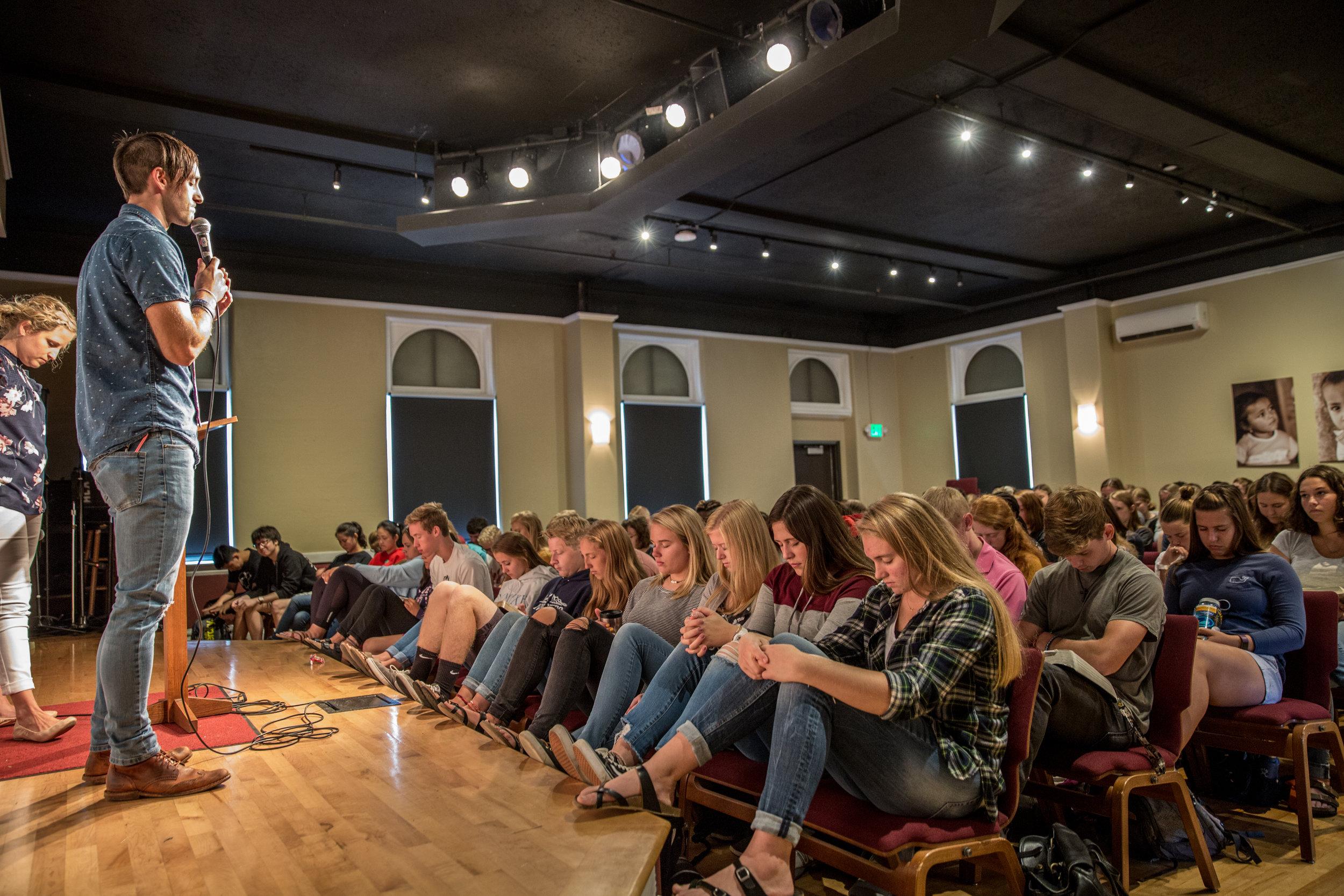Students Praying Ryan Garvin Chapel.jpg