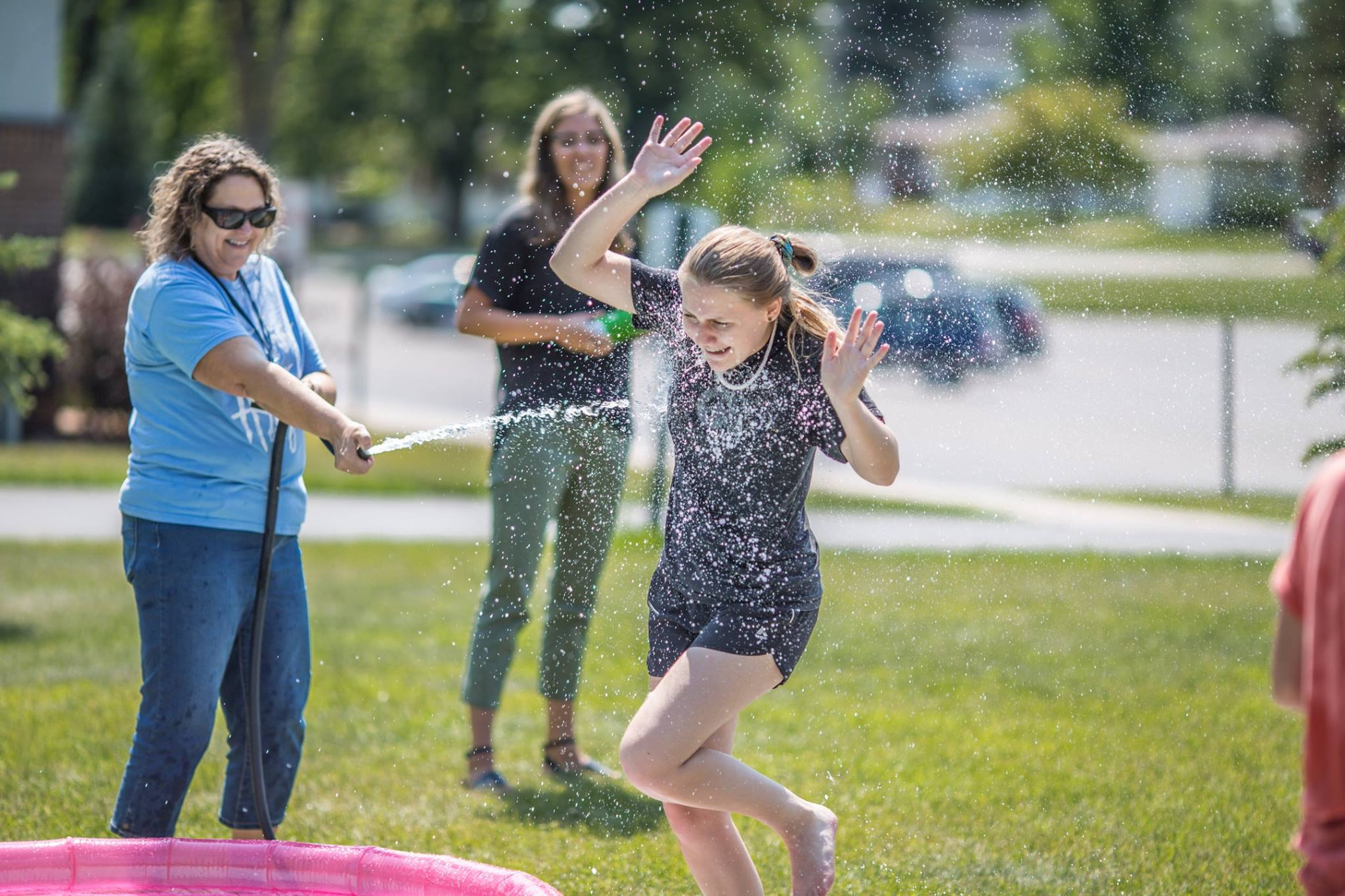 Students enjoy slip-n-slide kickball as one of the many activities planned during weekends.