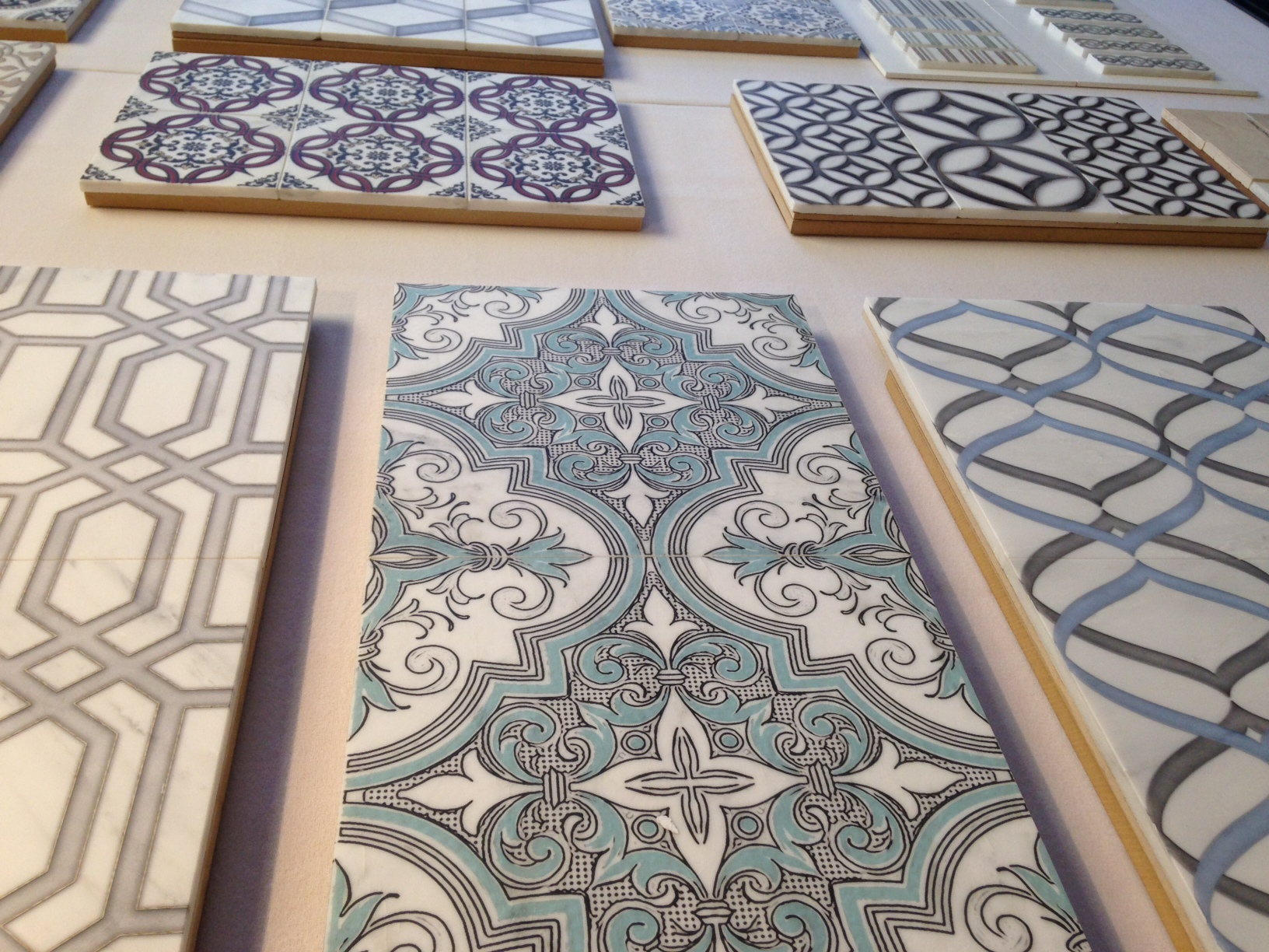 Come check out our new line of hand printed tile on Natural Stone. Available in a variety of colors, patterns and stones.
