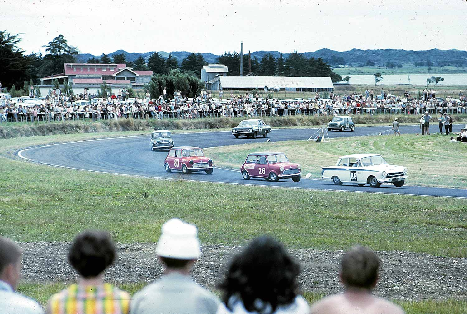 A Cortina leads a gaggle of Minis and an HR Holden