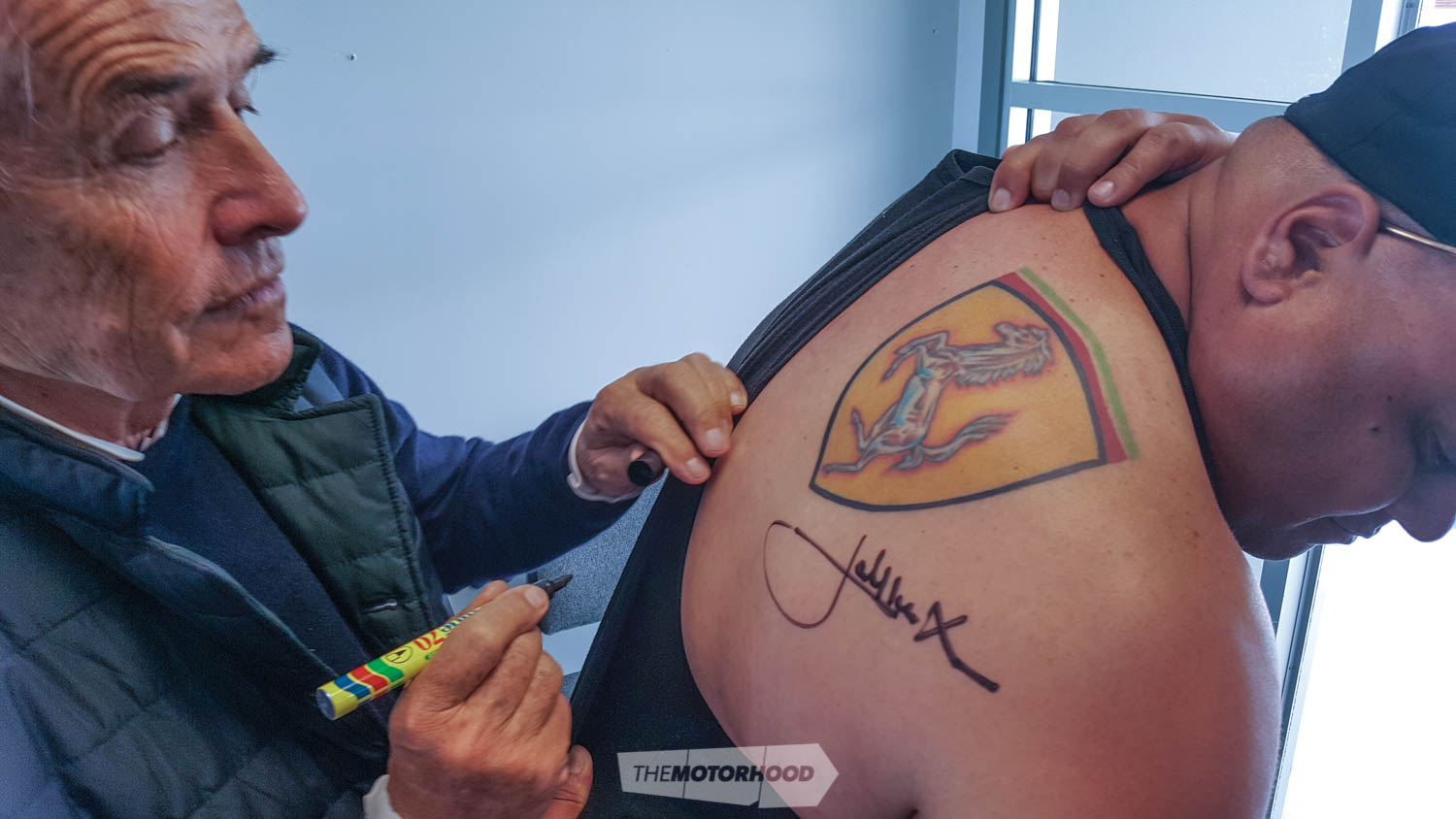 Jacky signs another autograph — this one to be tattooed