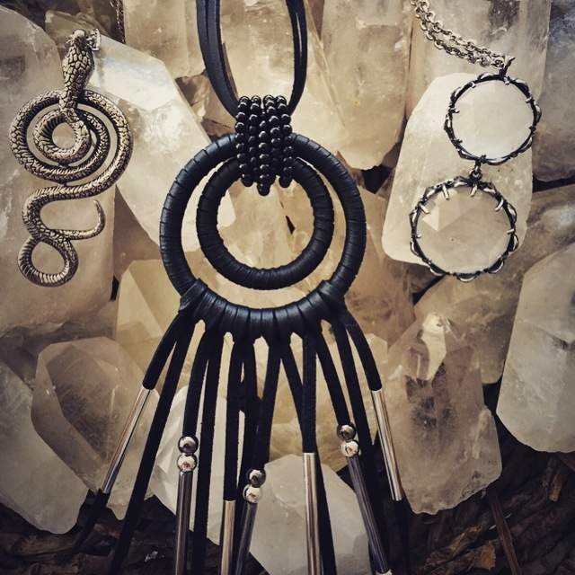 Shown here: Serpent Amulet, Chow Wheel Amulet, and the Freya Quartz Necklace.