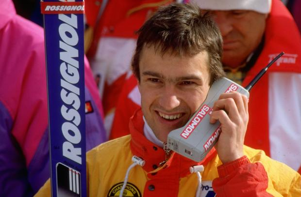 Franck Piccard     of France talks on his mobile phone after the Mens Super G Salomon event at the 1988 Winter Olympic Games in Calgary, Canada. Piccard won the gold medal with a time of 1:39.66 minutes.