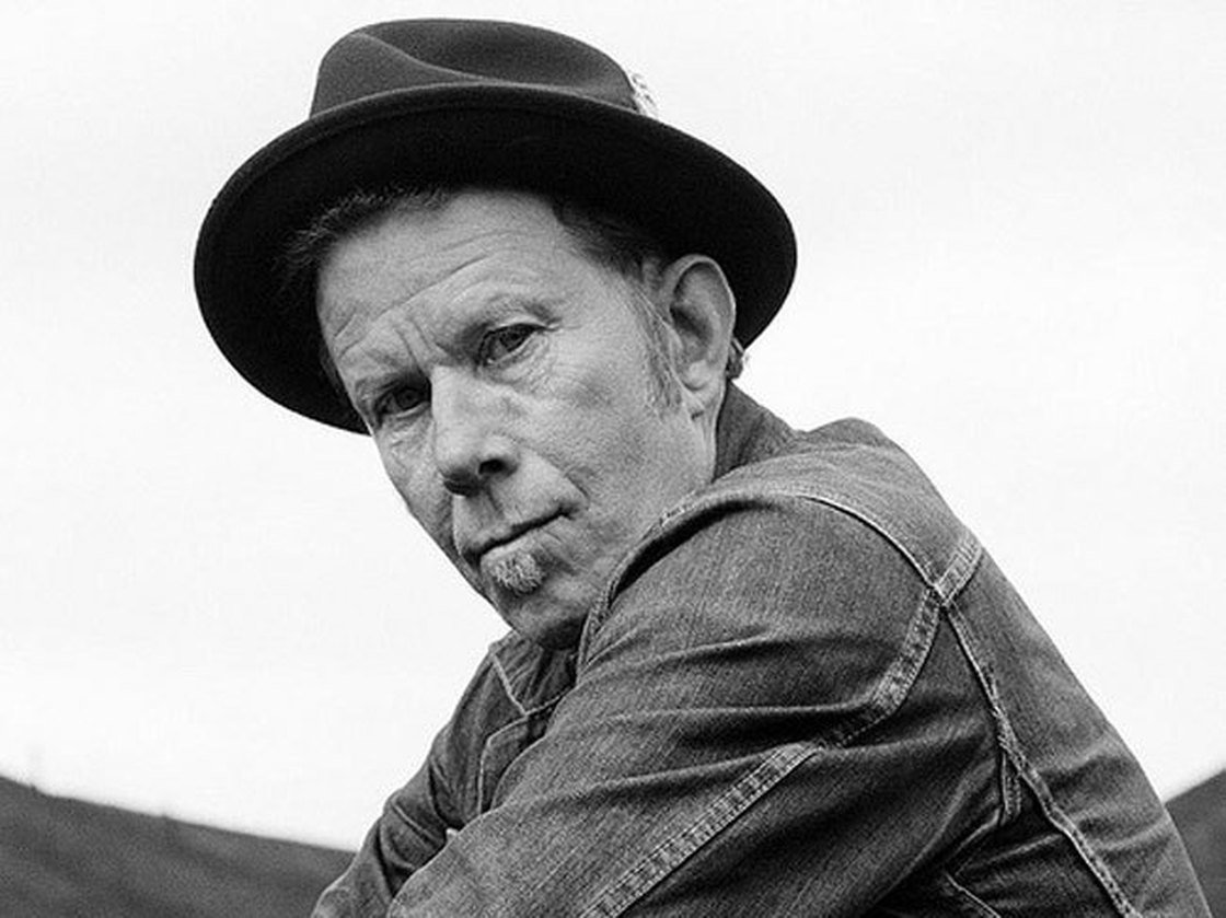Is Tom Waits a creative genius? No, Tom Waits HAS a creative genius who sometimes (well... often) comes down a sweeps a wave of creation his way.