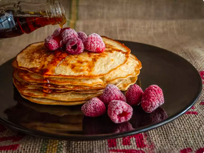 F for France and F for feast. People in France welcome the new year by feasting upon a stack of pancakes, foie gras and champagne. This feast is believed to bring good luck and prosperity.