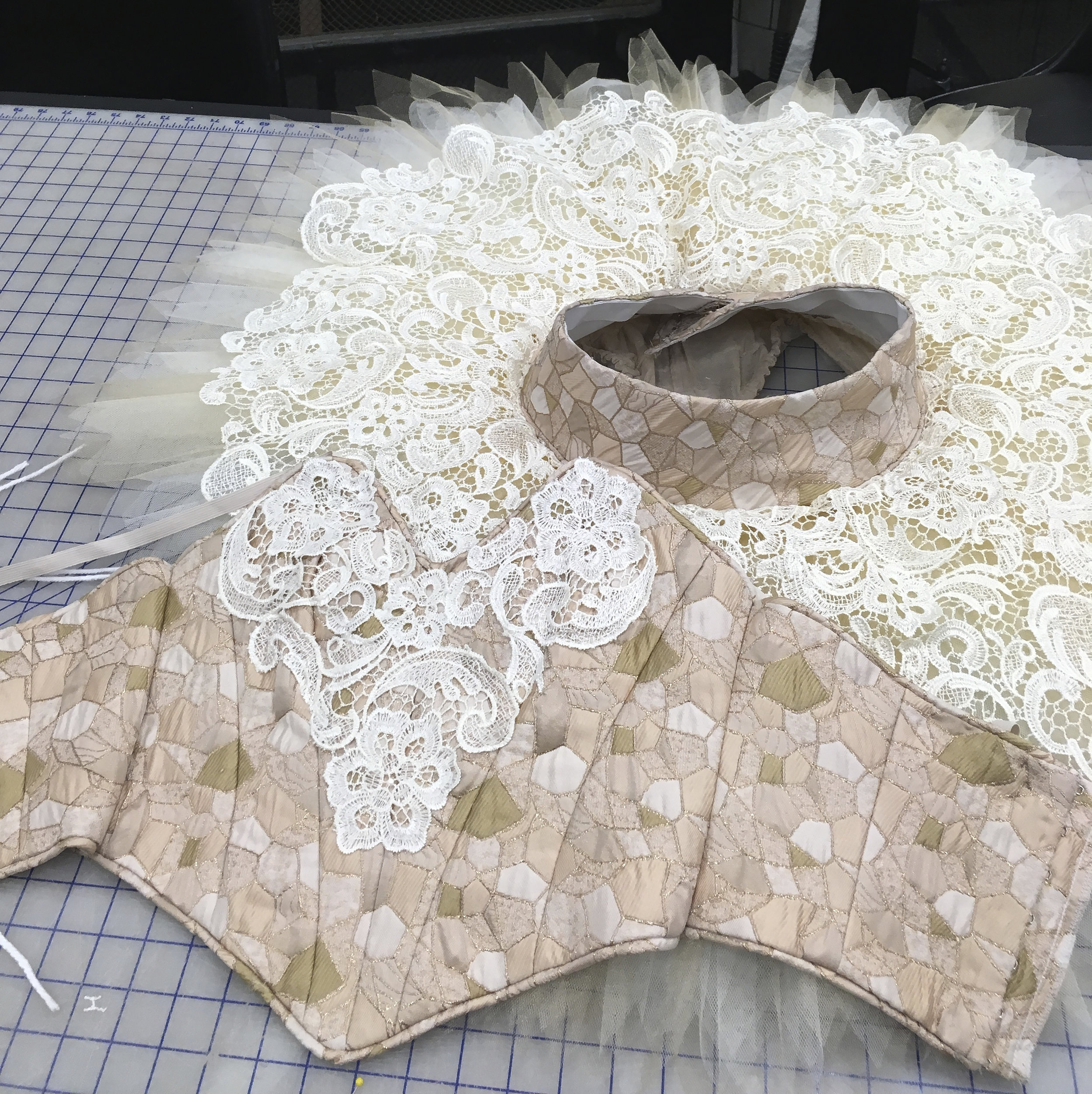 Bodice detail with alternate lace decoration.