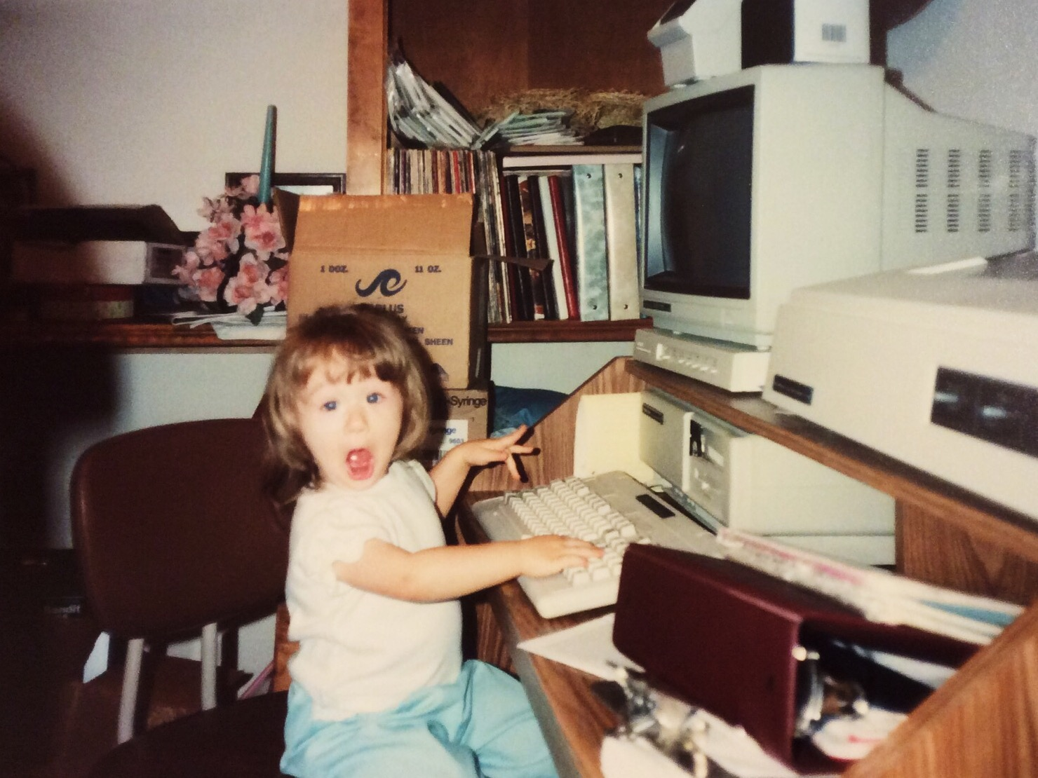 Myself as a toddler, most likely (trying) to play Wheel of Fortune on my parent's old Mac.
