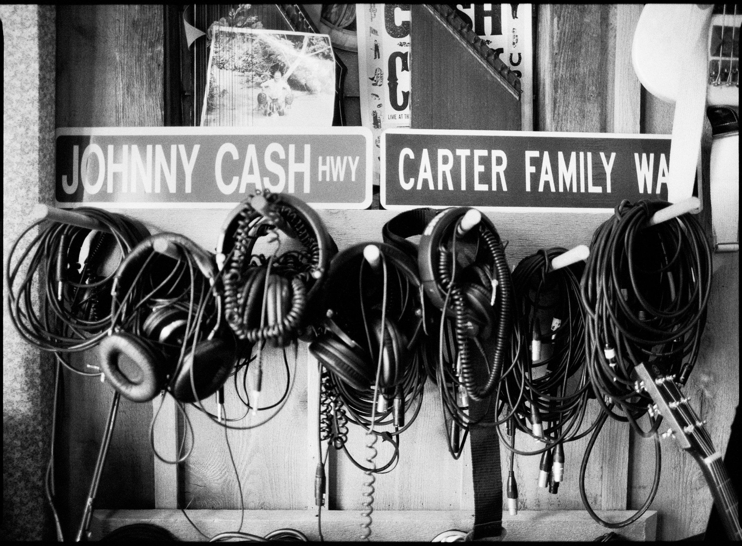 Cables and Headphones against Cash family memorabilia inside the studio.